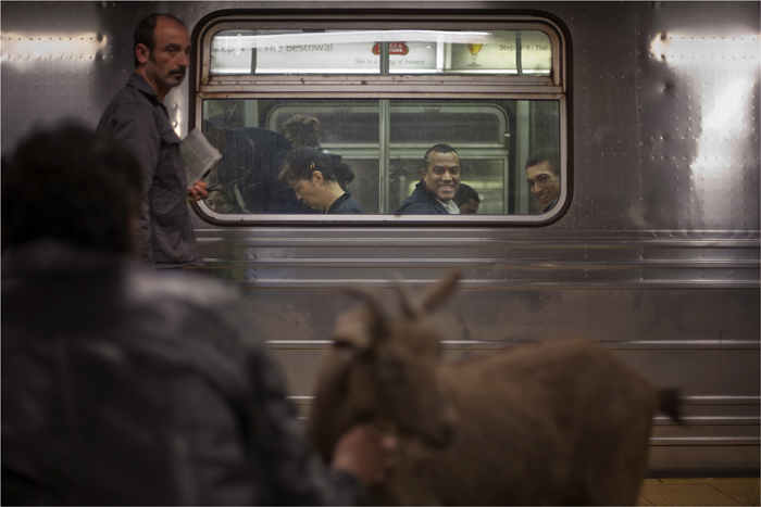 Cyrus Fakroddin and his pet goat Cocoa wait for the C train in New York