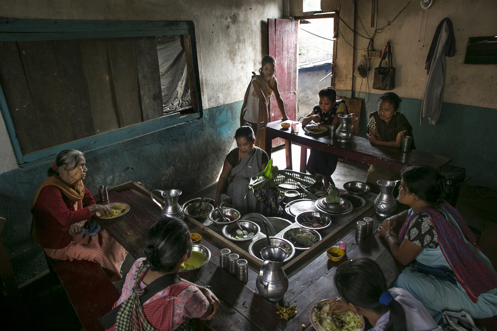 Women eat at a restaurant during their lunch break in Dowki